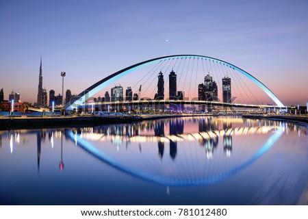 Dubai water canal at sun rise and colorful  bridge as viewed Dubai, United Arab Emirates on November 2017 Royalty-Free Stock Photo #781012480