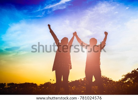 Silhouette of Happy family standing in field on sunset and holding hands #781024576