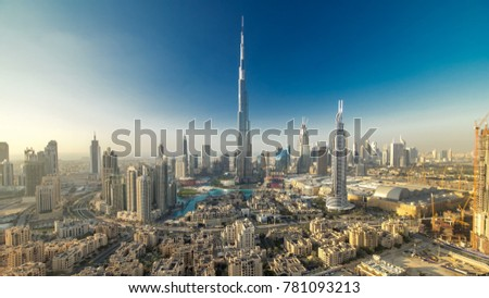 Dubai Downtown evening timelapse with Burj Khalifa and other towers paniramic view from the top in Dubai, United Arab Emirates. Shadows moves very fast. Traffic on circle road and fountains #781093213