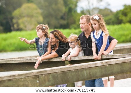 A family with young children together looking outward #78113743