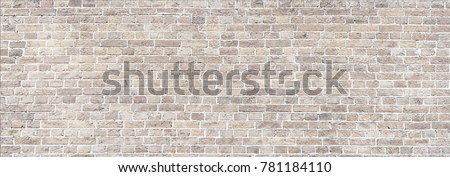 Wide Beige brick wall panoramic background texture. Home and office design backdrop Royalty-Free Stock Photo #781184110
