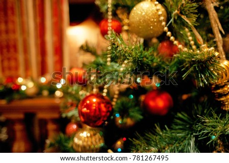 Christmas tree red and gold balls close up unfocused #781267495
