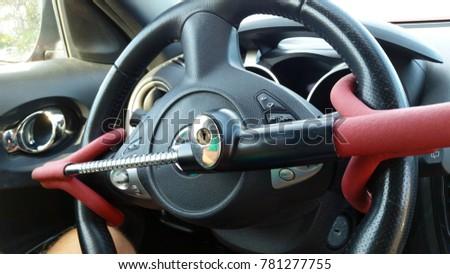 Anti-Theft Car Steering Wheel Lock. Black & red colors Royalty-Free Stock Photo #781277755