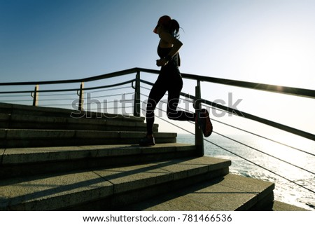 sporty fitness female runner running upstairs at coast trail #781466536