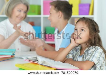 granny with grandchildren doing homework #781500070