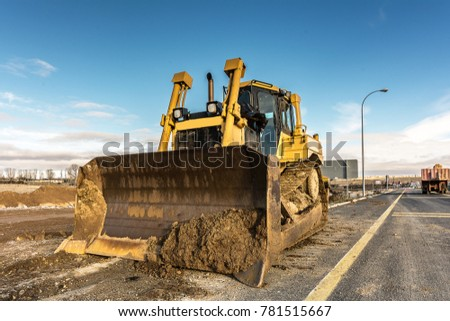 Excavator on a road construction site #781515667