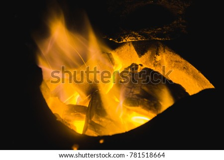 Charcoal burns in the furnace. Yellow flame #781518664
