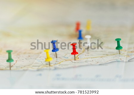 Map of a sea shore with route highlights and places of interest marked by colored pins. Vacations preparations idea, route planning concept. Close-up capture, selective focus, unrecognizable names. Royalty-Free Stock Photo #781523992