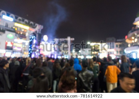 Hanoi-December,2017: Royalty high quality free stock image of blurred background: Bokeh lighting and people at music show outdoor on street. Outdoor stage is crowded in night