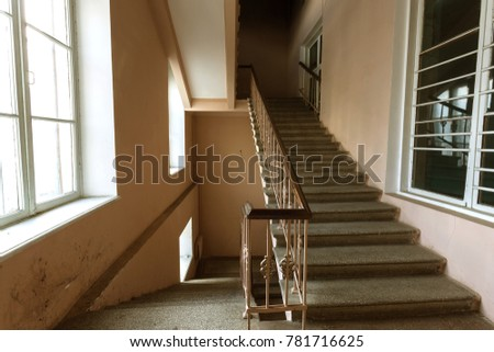 Cement, stone stairs of the old building. A vintage stone staircase between the floors of an obsolete building. Building fashion and technology of the 20th century in the USSR #781716625