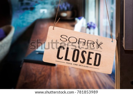 Wooden sign board with text hanging on door of cafe,closed sign board #781853989