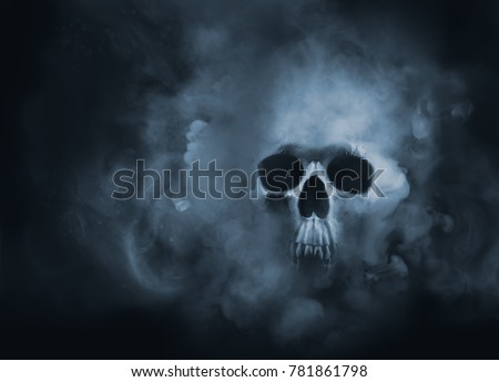 Scary skull emerging from a cloud of smoke / high contrast image Royalty-Free Stock Photo #781861798