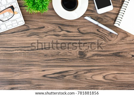 Brown wood office desk table and equipment for working and listening music with white headphone in top view and copy space. #781881856