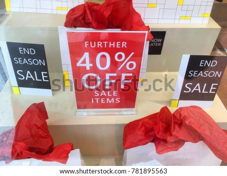 Boxing day and End of Season sale signs in retail shop window