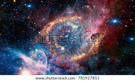 The Helix Nebula is a large planetary nebula located in the constellation Aquarius. Elements of this image furnished by NASA. Royalty-Free Stock Photo #781927855