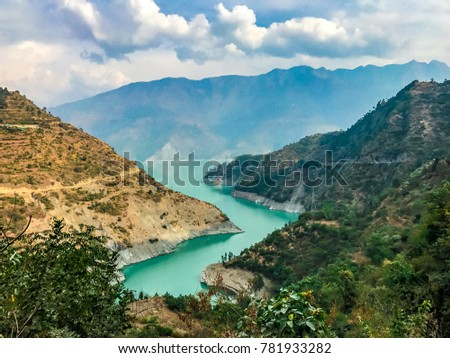 Magical views of landscape of Bhagirathi River near Tehri Dam in Chamba in Uttarakhand, India. Tehri Dam is the highest dam in India. Green mountains of Chamba in Uttarakhand is just mystical to eyes. #781933282