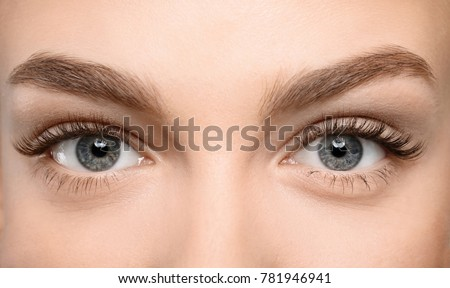 Beautiful female eyes with long eyelashes, closeup Royalty-Free Stock Photo #781946941