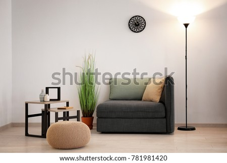 Elegant living room interior with sofa section and pouf #781981420