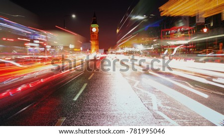 LONDON, circa 2017 - A long exposure night shot showing car light trails, the Westminster area and the Big Ben in London, England, UK  #781995046