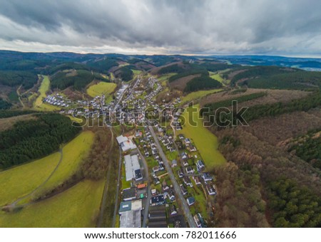 Aerial picture of the village Kirchveischede in the region Sauerland in Germany #782011666