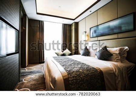 Elegant and comfortable home & hotel bedroom interior. #782020063
