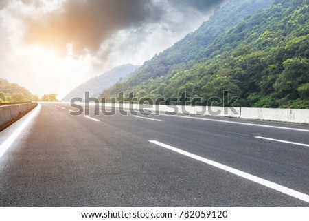 country road and mountains natural landscape in the summer #782059120