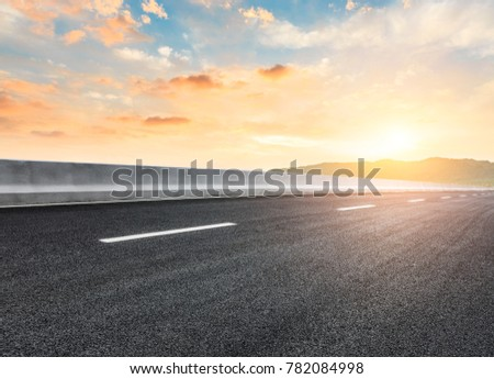 country road and hills natural landscape at sunset #782084998