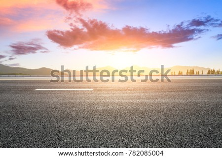 country road and hills natural landscape at sunset #782085004