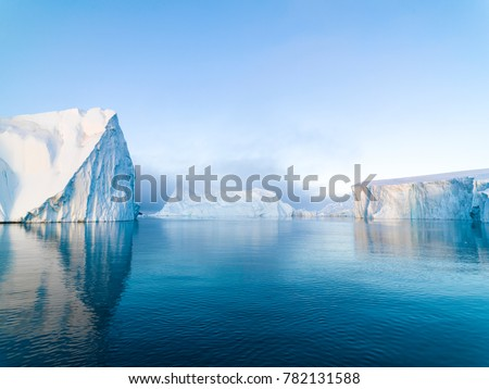 Arctic Icebergs on Arctic Ocean in Greenland Royalty-Free Stock Photo #782131588