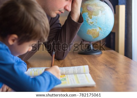 Sad father tired about helping little son in mathematics homework #782175061