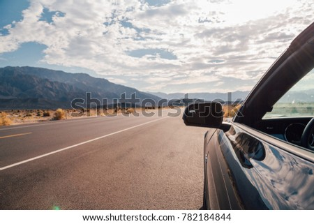 Driving in a black Ford Mustang GT through the Death valley in Nevada. Amazing road trip adventure. August 10, 2017, USA. #782184844