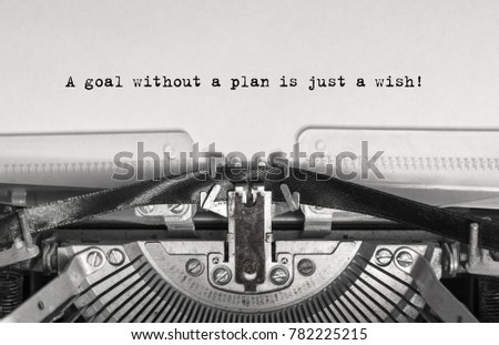 A goal without a plan is just a wish! close up, typed words on a vintage typewriter with vintage background #782225215