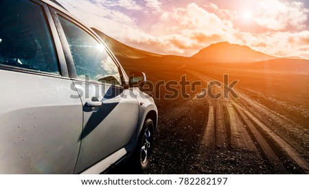 Off-road Jeep car on bad gravel road #782282197