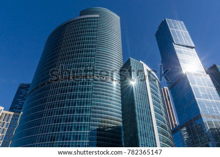 Sun clearly reflected in the walls of skyscrapers #782365147