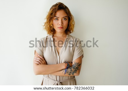 Portrait of sad or serious young woman in studio Royalty-Free Stock Photo #782366032