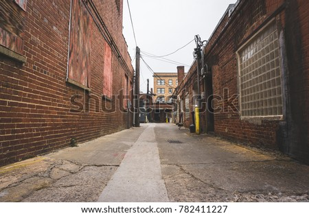 Lost Down The Long Brick Alley Way Royalty-Free Stock Photo #782411227