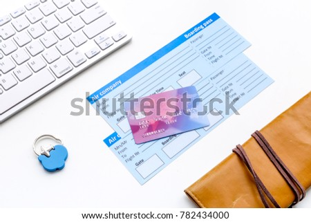 Book airplane ticket online. Documents near bank card, wallet and keyboard on white background top view #782434000