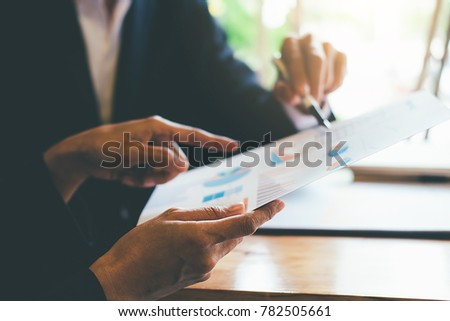 Administrator business man financial inspector and secretary making report  calculating balance. Internal Revenue Service checking document. Audit concept #782505661