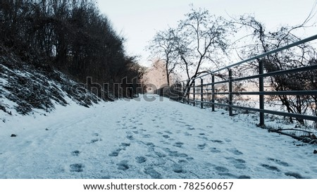 Snow-covered roads and footprints #782560657