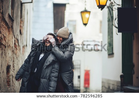 Happy young couple holding hand on winter vacation