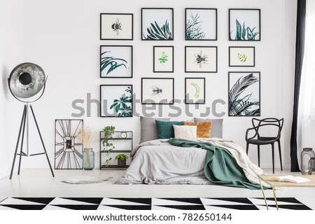 Spacious botanic themed bedroom interior decorated with posters of herbs and bugs #782650144