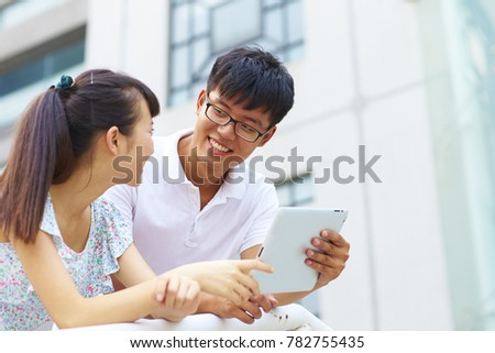 happy young asian or Chinese people using tablet outdoor #782755435