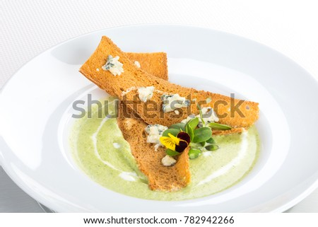Blue cheese and broccoli soup with crispy baguette #782942266