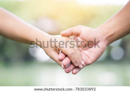 Woman and man holding hands, Happy couple lover in the garden. #783033892