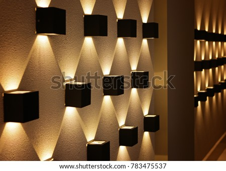 black light in the form of a cube on the wall, perspective, yellow light, a graphic pattern of light.  #783475537