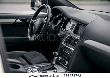 Luxury car interior. Steering wheel, shift lever and dashboard. Royalty-Free Stock Photo #783478792