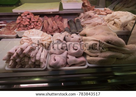 Beef and Pork pieces for sale at a counter in the Salamanca Central Market, Mercado Central #783843517