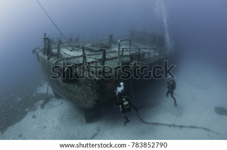 Shipwreck diving underwater Royalty-Free Stock Photo #783852790
