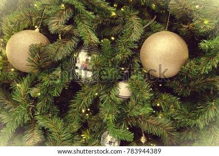 Decorated Christmas tree on blurred, sparkling background #783944389