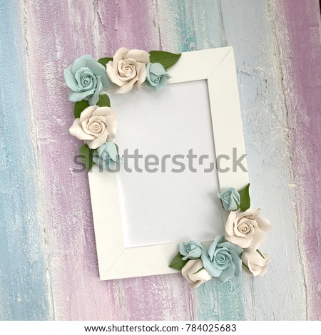 Delicate frame for congratulations or photos on a colored wooden background